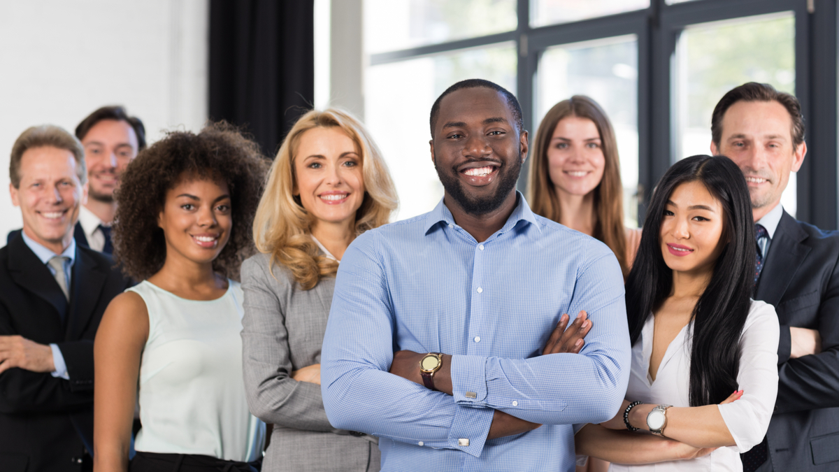 Smiling diverse business people standing with folded arms | Canadian Permanent Residency