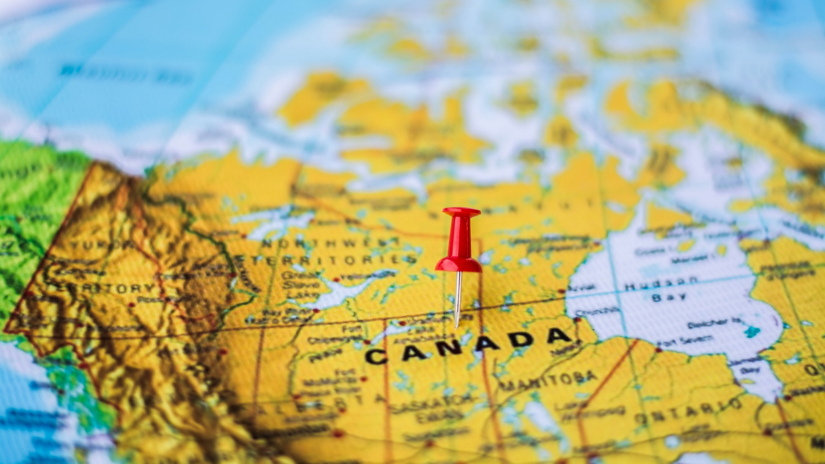 map of Canada with red map pin | How to Apply for a Work Visa in Canada as a Nurse