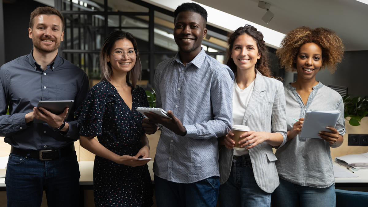 multicultural professional workers smiling in office| job in Canada