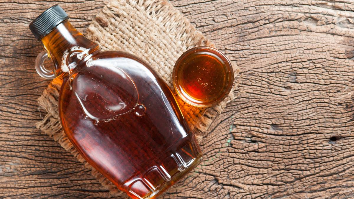 maple syrup in a glass bottle and small glass |Why You Should Take a Foodie Holiday in Canada